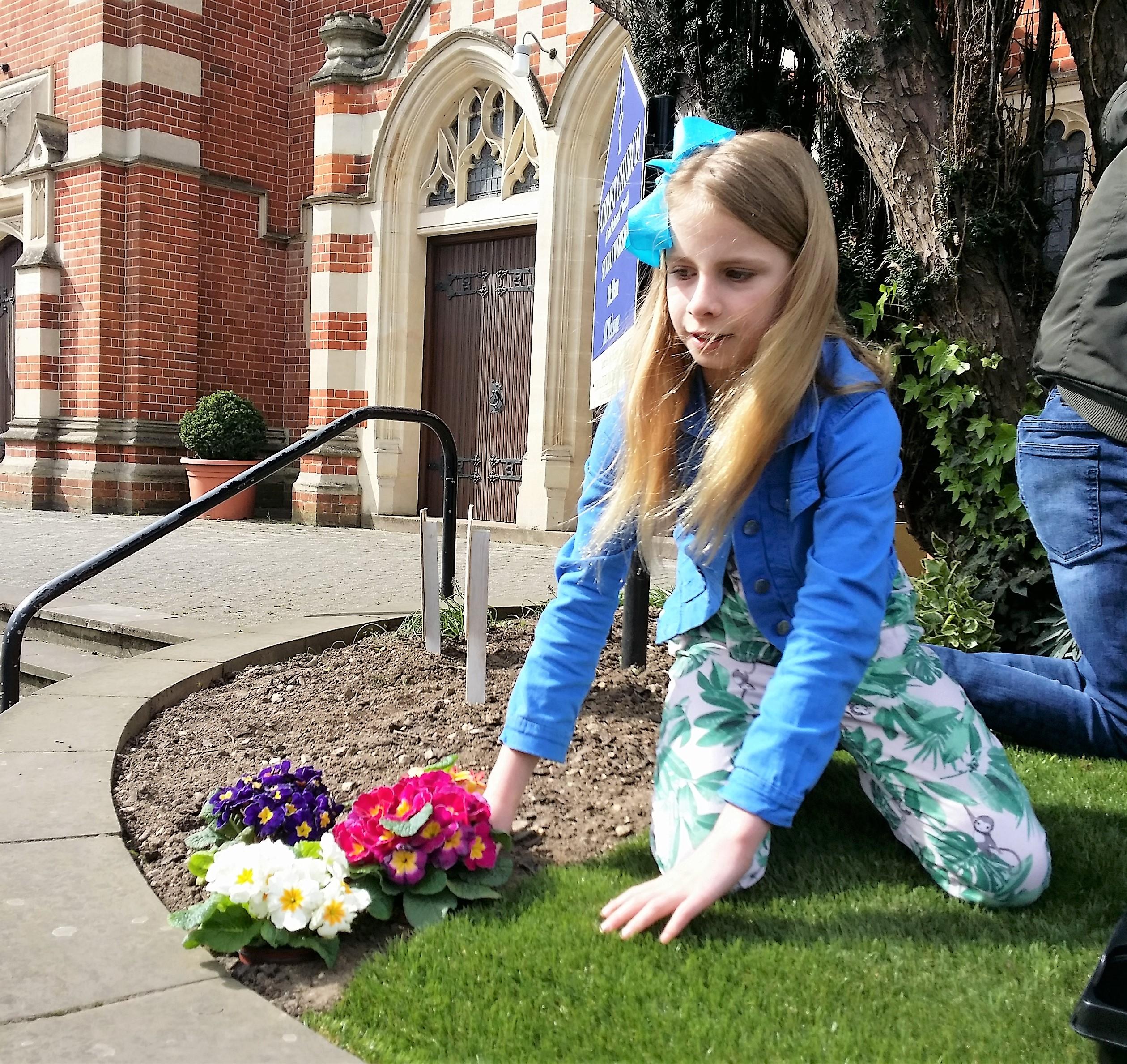 Easter-Garden-girl-planting-flowers-